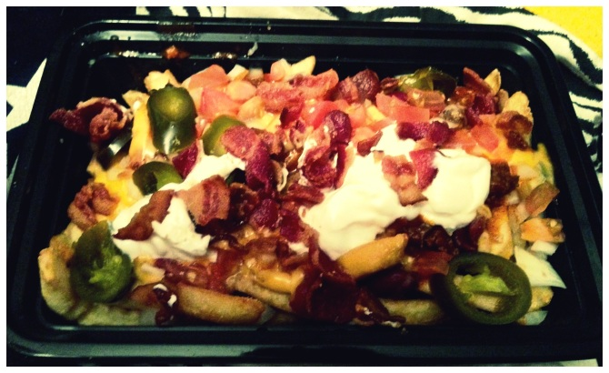 the delicious dinner I had post-game from Freddie's: Atomic Fries. Filled with favorites like bacon, sour cream, & jalapenos.