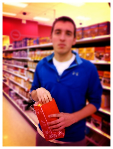 michael needs popcorn to walk the aisles of Target.
